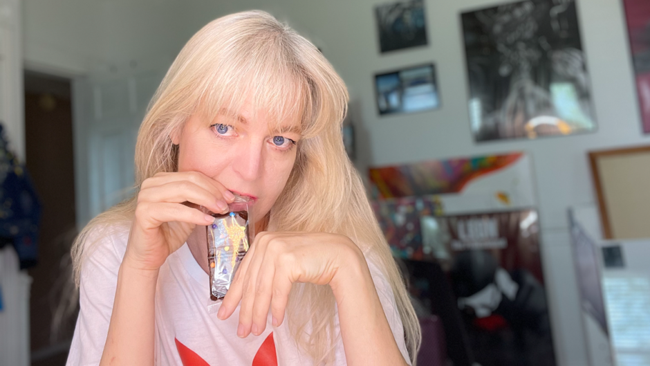header photo of Melissa Whitaker biting into a wrapped cosmic brownie